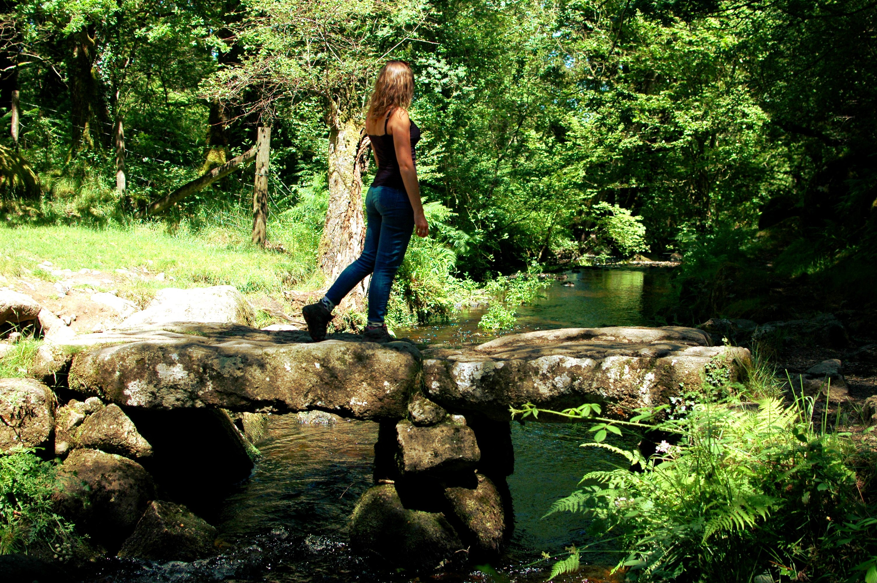 Walking across bridge in Dartmoor, Devon, England